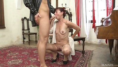 Mature swallows sperm after insane home fellow-feeling a amour