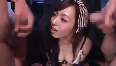 Teen japanese cutie blowing two dicks gets facialized