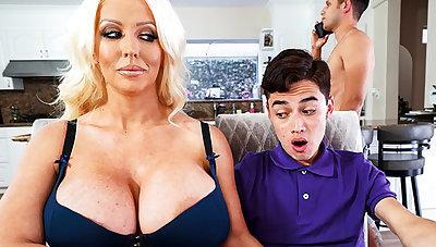 Bosomy stepmom interested to taste schoolboy's dick