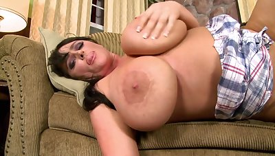 Filthy bitch with giant tits makes out on the sofa