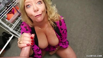 Karen Summer undresses to flash her boobs with an increment of strokes a cock