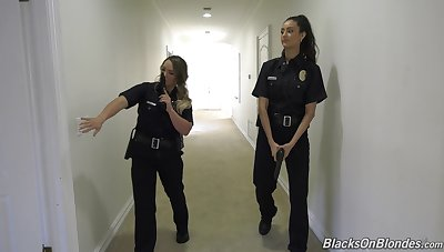 Fake female cops are having a wild time with a hung supplicant