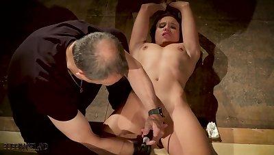 Pledged slave made to orgasm in bondage sex