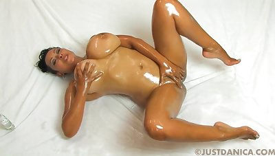 Chubby titted brunette oily Joi - fingering shiny cunt